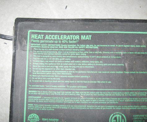 Close up photo of a seedling heat mat